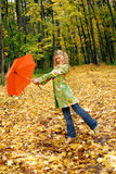Girl and orange umbrella Royalty Free Stock Photography