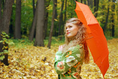Girl and orange umbrella Stock Image