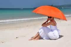 Girl with an orange umbrella Royalty Free Stock Image