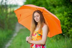 Girl with an orange umbrella Royalty Free Stock Photography