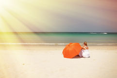 Girl with an orange umbrella Royalty Free Stock Images