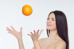 Girl and orange Royalty Free Stock Photos