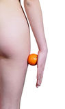 The girl with orange on a white background Royalty Free Stock Images