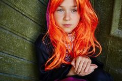 Girl in orange wig Stock Photos