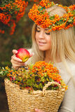 Girl in Orange wreath with Red Apple in hand Royalty Free Stock Photos