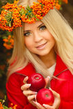 Girl in Orange wreath with Red Apple in hand Stock Images