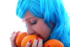 Girl with oranges Stock Image