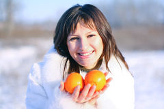 A girl with oranges Royalty Free Stock Photo