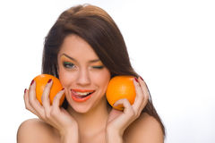 Girl with oranges Stock Photography