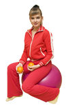 The Girl with oranges on fitbol. The image of the girl engaged on fitbol with oranges Stock Photography