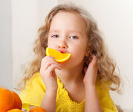 Girl with oranges at home Royalty Free Stock Image