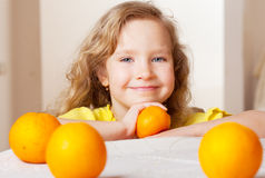 Girl with oranges at home Stock Photo