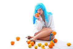 Girl with oranges and lemons Royalty Free Stock Photography