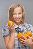 Girl with oranges Royalty Free Stock Images