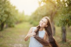 girl in orchard. garden with flowering trees. Allergy season. Dancing jumps stock images