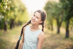 girl in orchard. garden with flowering trees. Allergy season. Dancing jumps royalty free stock images