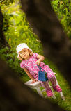 Girl in an orchard Stock Image