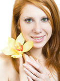 Girl with orchid Royalty Free Stock Photo