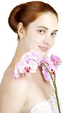 Girl with orchid Royalty Free Stock Photography