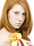 Girl with orchid_20 Royalty Free Stock Image