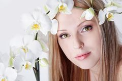 Girl with orchid Royalty Free Stock Image