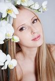 Girl with orchid Royalty Free Stock Photos