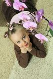 Girl with Orchid Stock Images