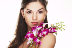 Girl with orchid Royalty Free Stock Images