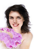 Girl with orchid and big smile Stock Photos