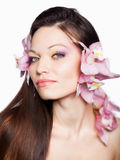 Girl with orchid in hair Royalty Free Stock Photos