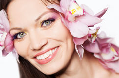 Girl with orchid in hair Stock Photo
