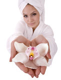 Girl with orchid and white towel on head . Royalty Free Stock Image