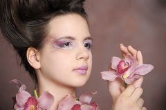 Girl with orchids Royalty Free Stock Photography