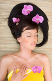 Girl with orchids royalty free stock photo