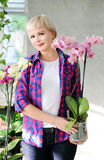 Girl with orchids Royalty Free Stock Photos