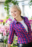 Girl with orchids Stock Photography