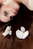Girl with orchids in hair Royalty Free Stock Photography