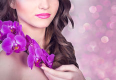 Girl with orchids Royalty Free Stock Image