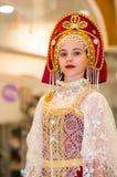 The girl in the Orenburg downy shawl Stock Photo