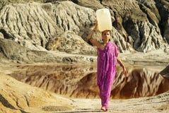 Heavy burden of women royalty free stock photo