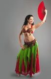 Girl in oriental arabian costume with fan Royalty Free Stock Photography