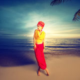 Girl in oriental style on the beach at sunset Royalty Free Stock Photo
