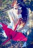 Girl with origami crane. Girl with red origami crane stock photos