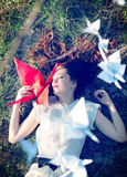 Girl with origami crane. Girl with red origami crane stock images