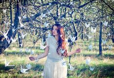 Girl with origami cranes Royalty Free Stock Photo