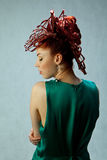 The girl with the original hairstyle. Pretty graceful girl with model complicated hairdo Royalty Free Stock Images