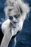 Girl with original make-up. Girls face with original make-up - fake eyelashes royalty free stock photo