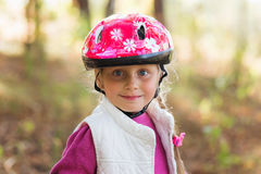 Girl with an orthopedic helmet smiles for the camera Stock Photos