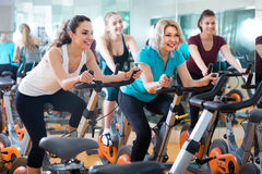 Girl and other females working out in sport club Royalty Free Stock Images