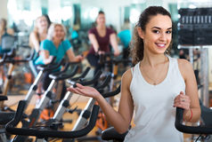 Girl and other females working out in sport club. Brunette happy european girl and other females working out in sport club Royalty Free Stock Photos